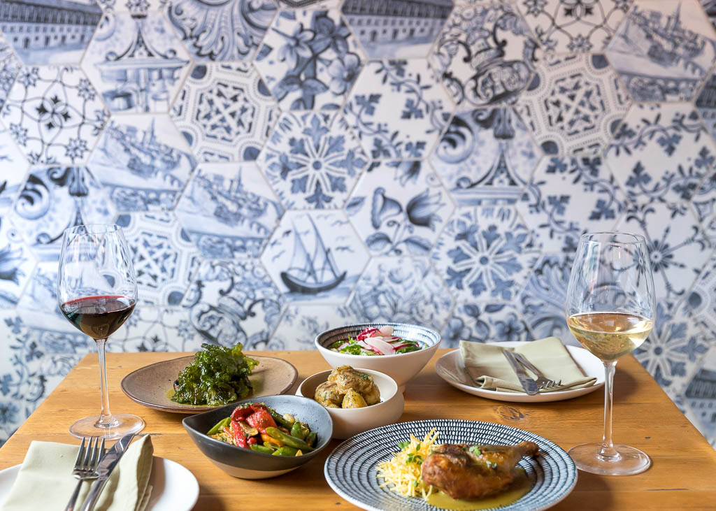 Food dishes and wine glasses at Canto