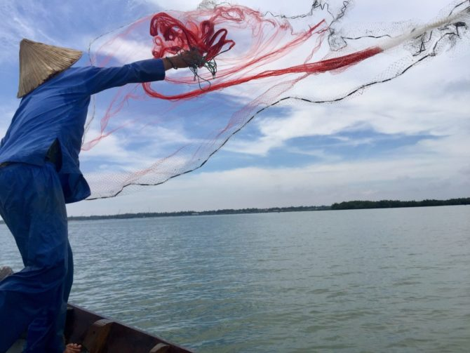 Vietnamese Fisherman Cast Net Fishing in Hoi An, Vietnam