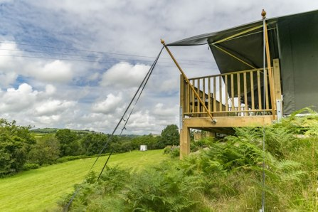 An image of the corner or Seren one of our safari tents and the glamping field beyond
