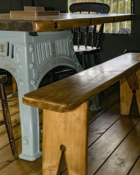 An image of the bespoke, reclaimed table in Afon