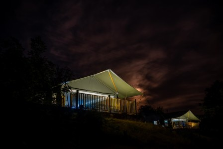 Afon and Seren safari tents at night