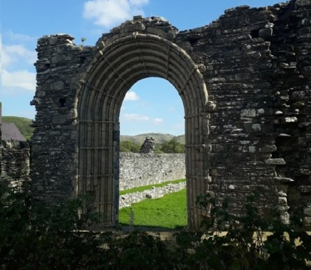The stone arch at Strata Florida and the countryside beyon
