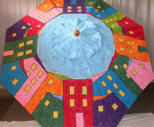 A full spectrum of color in this delightful Hand Painted Market Umbrella named for a town in Italy with colorful houses.