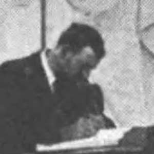 Man writing in guestbook