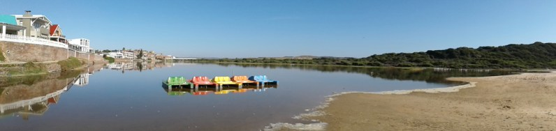 Pedal boats and flamingos near the Hartenbos River mouth