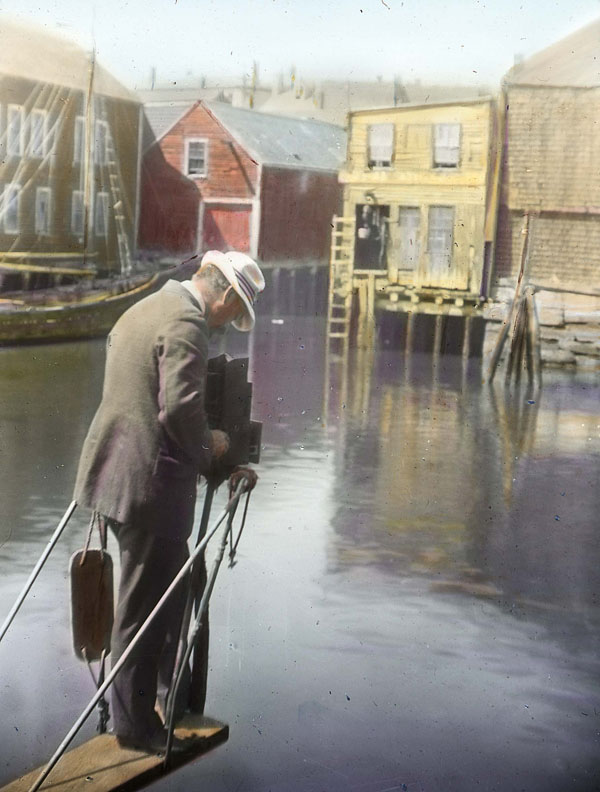 A photographer in the pulpit of a sword fishing vessel, Gloucester, MA (possibly Vincent's Cove). Fishermen's Institute lecture slides, c. 1921. Collection of the Cape Ann Museum Library & Archives.