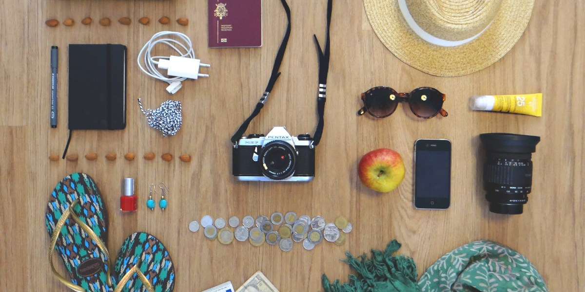 Flat lay fifteen ultimate travel essentials