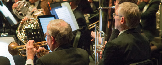 Two of the Cape Cod Concert Band's trumpet players prepare for a concert