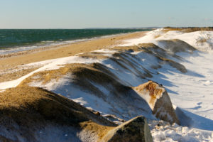 sand dune with snow on top