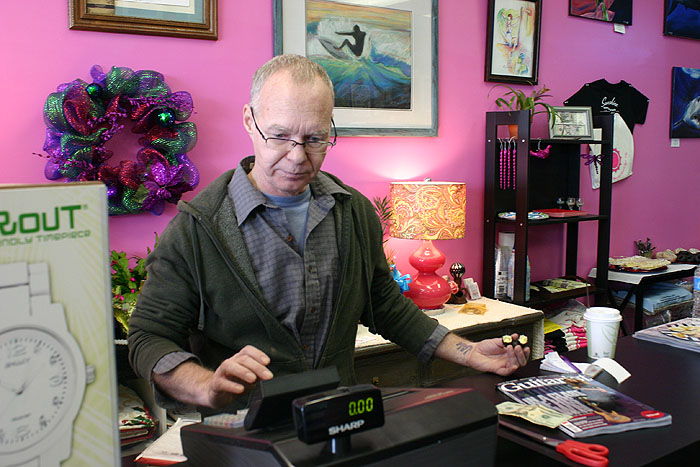 Owner Ron Sayles rings up a sale. Yeah!!