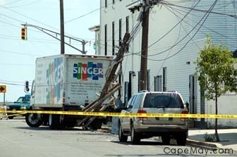 A truck takes down powerlines at the corner of Decatur and Beach