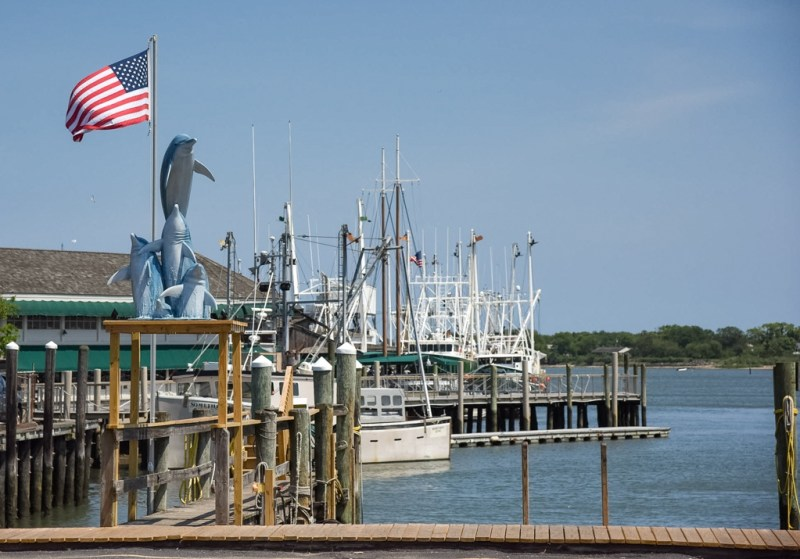 Cape May Harbor seen from the Lobster House with scalloping boats in the distance