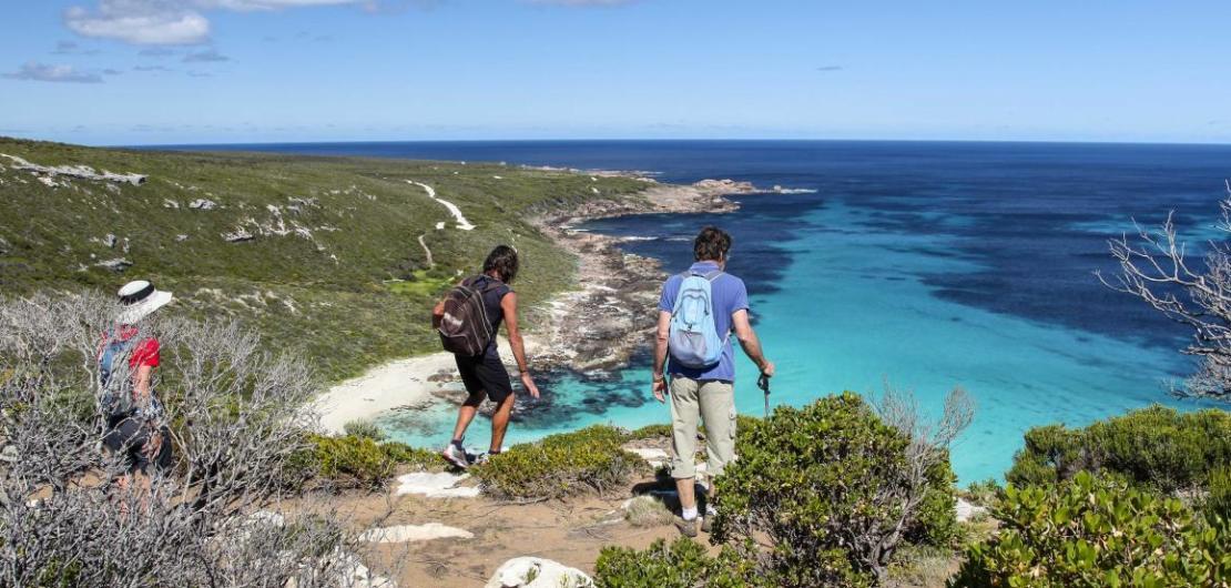 Hikers above beautiful Contos Beach