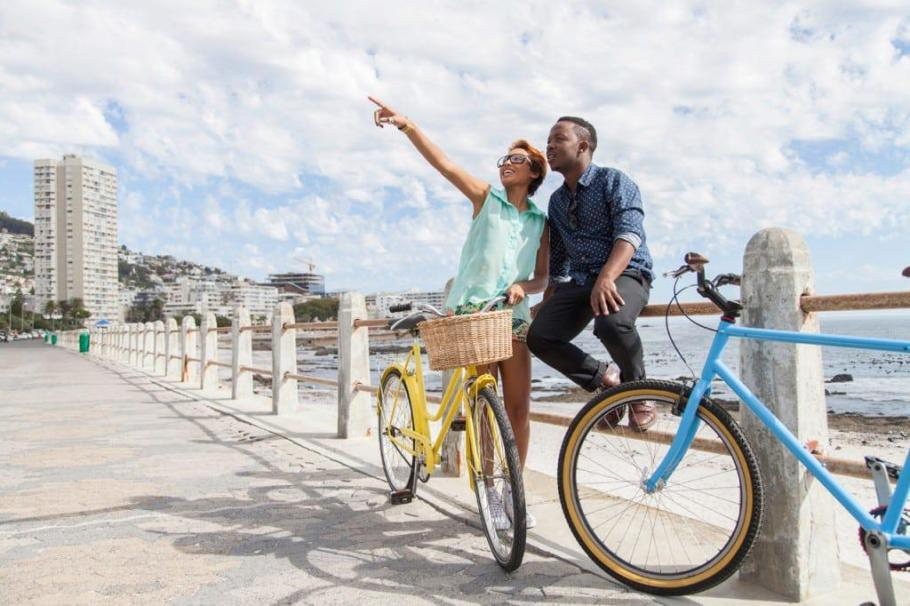 hello_weekend_couple_cycling_sea_point_promenade_istock