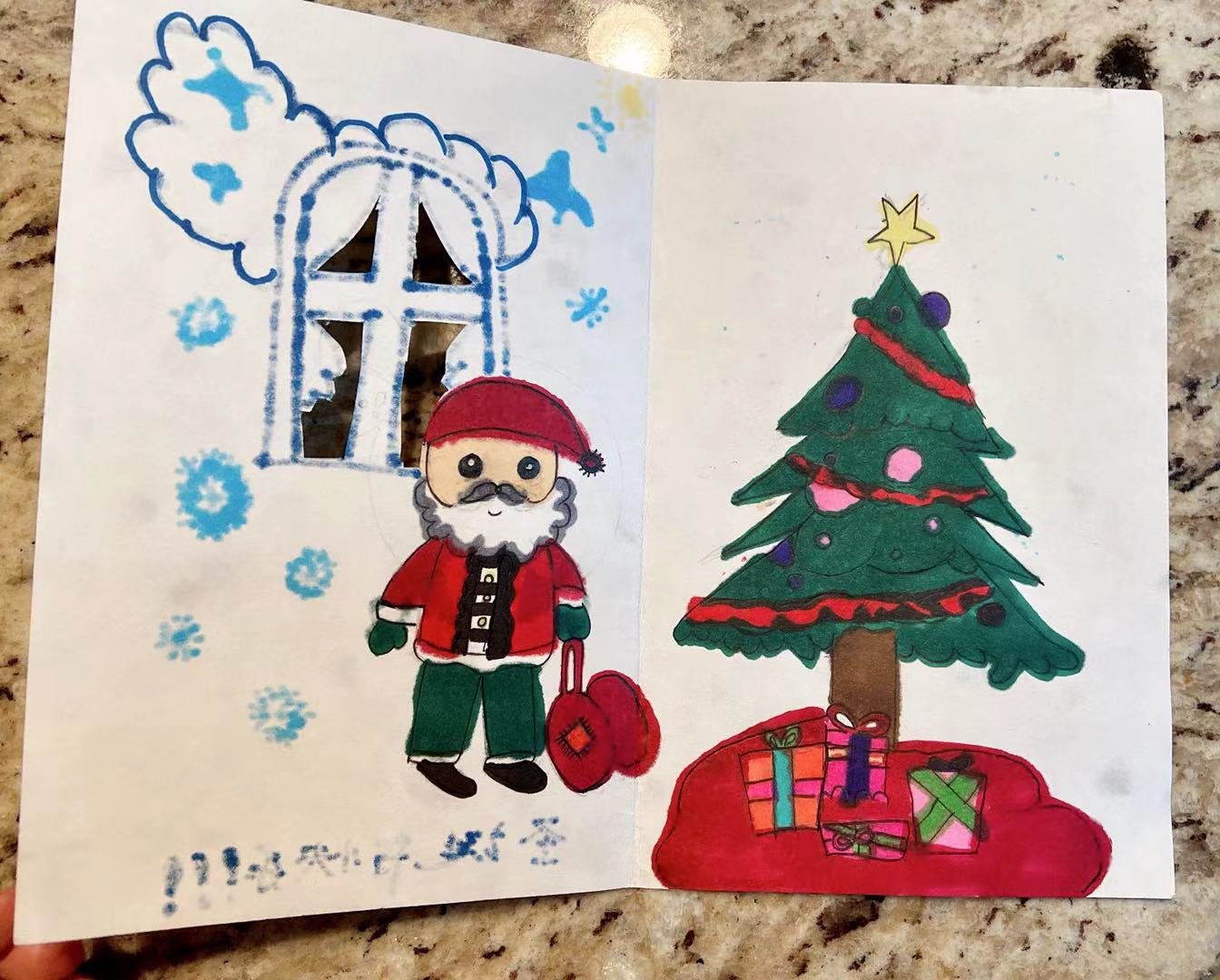 A card with a snowman and a christmas tree  Description automatically generated with low confidence