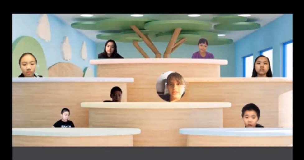A group of people in a room Description automatically generated with low confidence