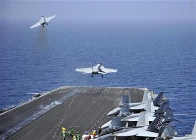 F/A-18F Super Hornets assigned to Carrier Air Wing One (CVW-1) launch  from the aircraft carrier USS Enterprise in the Red Sea in this U.S. Navy handout photo dated March 17, 2011.  U.S. Navy/Mass Communication Specialist Seaman Jared M. King/Handout)