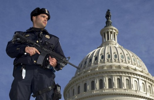 Capitol Police officer Angel Morales, stands on guard on the West side of the Capitol in Washington Friday, Feb. 17, 2012. A 29-year-old Moroccan man was arrested Friday in an FBI sting operation near the U.S. Capitol while planning to detonate what police say he thought were live explosives. (AP Photo/Manuel Balce Ceneta)
