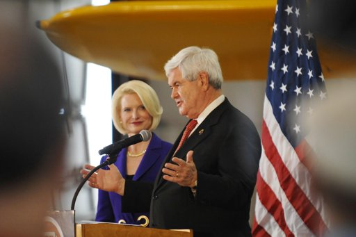 Newt Gingrich and wife Calista. He says he's not going anywhere (AP Photo/Daily Herald, John Starks)