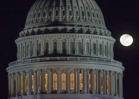 "The moon rises behind the U.S. Capitol Dome in Washington as Congress works into the late evening, Sunday, Dec. 30, 2012 to resolve the stalemate over the pending ""fiscal cliff."" (AP Photo/J. David Ake)"