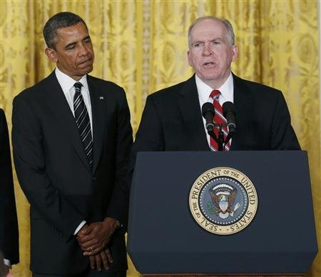 President Barack Obama (L) stands next to John Brennan, (R), during the announcement for his nominations for a new secretary of defense and new CIA director at the White House in Washington January 7, 2013.REUTERS/Kevin Lamarque