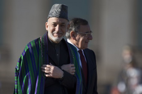 Afghan President Hamid Karzai smiles as he and Defense Secretary Leon Panetta arrive for a full honors arrival ceremony, Thursday, Jan. 10, 2013, at the Pentagon. (AP Photo/ Evan Vucci)