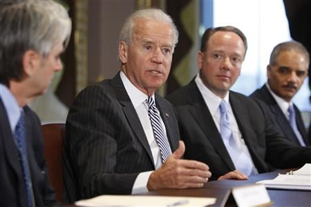 Vice President Joe Biden flanked by video game execs and others at meeting.(Reuters)