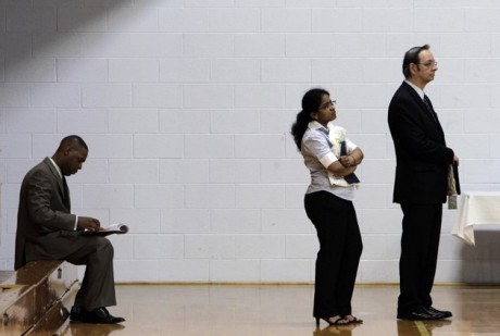 Job seekers wait in a line at a job fair in Southfield, Mich. In the United States, half of the 7.5 million jobs lost during the Great Recession were paid middle-class wages, ranging from $37,000 to $68,000. But only 2 percent of the 3.4 million jobs gained since the recession are mid-pay. (AP Photo/Paul Sancya, File)