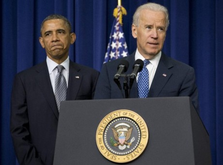 President Barack Obama listens at left as Vice President Joe Biden speaks about proposals to reduce gun violence in the South Court Auditorium at the White House in Washington. There is a legal avenue to get any gun you want somewhere in the U.S., thanks to the maze of gun statutes across the country and the lack of federal laws. An Associated Press analysis finds that there are thousands of laws, rules and regulations at the local, county, state and federal levels.  (AP Photo/Carolyn Kaster, File)