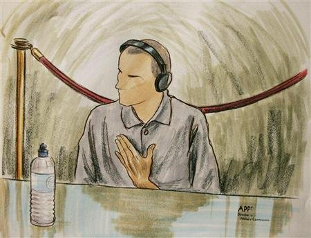 In this courtroom illustration, Ali Hamza Ahmad Sulayman al Bahlul appears before a military commission at Guantanamo Naval Base August 26, 2004 in Guantanamo, Cuba. Bahlul is charged with conspiracy to commit war crimes.  REUTERS/Art Lien/POOL