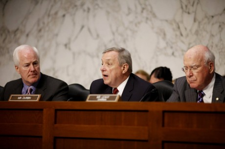 """Sen. Richard Durbin, D-Ill., center, flanked by Sen. John Cornyn, R-Texas, left, and Sen. Patrick Leahy, D-Vt., speaks during a meeting on Capitol Hill in Washington. The Senate holds its second hearing Tuesday, Feb. 12, 2013, on gun curbs since the December 2012 shooting deaths of 20 first-graders in Newtown, Conn. This time, a Senate Judiciary subcommittee is examining the constitutionality and effectiveness of federal firearms limits. """"We need to keep guns out of the hands of criminals and those who are mentally unstable,"""" Durbin, D-Ill., said in a brief interview Monday, Feb. 11, 2013. """"I hope everyone will acknowledge what within our Constitution is not only an individual right to bear arms, but the collective right of Americans to be safe.""""  (AP Photo/Charles Dharapak, File)"""