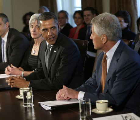 President Barack Obama welcomes his new Defense Secretary Chuck Hagel, right, as he speaks to members of the media at the start of a cabinet meeting in the Cabinet Room of the White House in Washington, Monday, March 4, 2013. From left are, Education Secretary Arne Duncan, Health and Human Services Secretary Kathleen Sebelius, Obama and Hagel. (AP Photo/Pablo Martinez Monsivais)