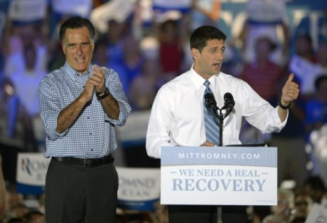 Republican presidential candidate, former Massachusetts Gov. Mitt Romney, left, applauds as he is introduced to supporters by his vice presidential running mate Rep. Paul Ryan, R-Wis., during the Romney Ryan Victory Rally in Daytona Beach, Fla., Friday, Oct. 19, 2012.  (AP Photo/Phelan M. Ebenhack)
