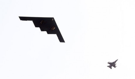 U.S. Air Force B-2 stealth bomber, left, flies over near Osan U.S. Air Base in Pyeongtaek, south of Seoul, South Korea, Thursday, March 28, 2013. A day after shutting down a key military hotline, Pyongyang instead used indirect communications with Seoul to allow South Koreans to cross the heavily armed border and work at a factory complex that is the last major symbol of inter-Korean cooperation. (AP Photo/Lee Jung-hun, Yonhap)