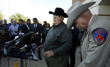David Byrnes, Sheriff of Kaufman County, right, bowing his head as Mike McLelland, District Attorney of Kaufman County answers questions at a news conference at the Kaufman Law Enforcement Center in Kaufman, Texas. McLelland and his wife where found dead in their home Saturday March 30, 2013. Authorities are investigating. (AP Photo/The Dallas Morning News, David Woo, File )