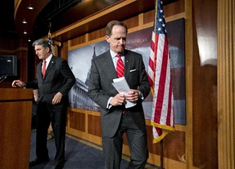 Sen. Pat Toomey, R-Pa., right, and Sen. Joe Manchin, D-W.Va., finish a news conference on Capitol Hill in Washington, Wednesday, April 10, 2013, announcing that they have reached a compromise on background checks for gun buyers in the aftermath of the horrific Connecticut school shootings in December 2012.  (AP Photo/J. Scott Applewhite)
