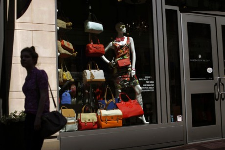 A woman walks past a retail store's window display in Baltimore.  (AP Photo/Patrick Semansky)