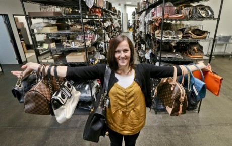 Sarah Davis, co-owner of Fashionphile.com, posing with her bags in a company warehouse in the Carlsbad, Calif. The Internet company sells rare, vintage, and discontinued previous owned bags and is facing the complicated task of dealing with new state regulations on Internet sale taxes. (AP photo/Lenny Ignelzi)