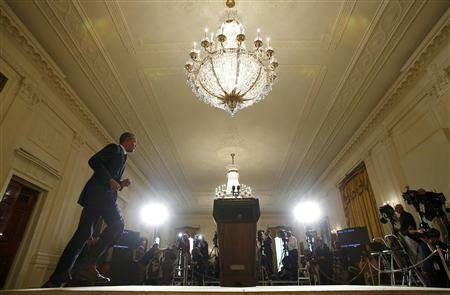 President Barack Obama takes the stage to deliver a statement in the East Room of the White House in Washington. (REUTERS/Kevin Lamarque)