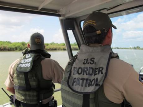Border Patrol agents Henry Davis and Arturo Vela patrol the Rio Grande by boat.