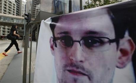 A banner supporting Edward Snowden.  (AP Photo/Kin Cheung)