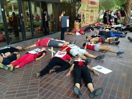 Demonstrators outside the Arizona office of Sen. John McCain (AP)