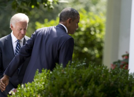 A chastened President Barack Obama leaves a White House press conference with Vice president Joe Biden after saying he will wait for Congressional approval before attacking Syria (AP/Evan Vucci)