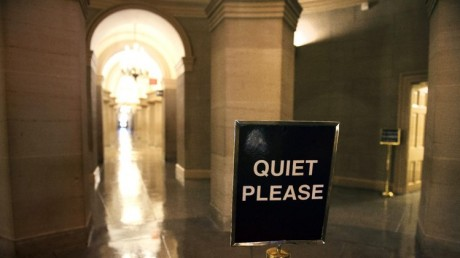 An empty hallway in the U.S. Capitol Sunday morning, Sept. 29, 2013, as a government shutdown looms/ (AP Photo/Cliff Owen)