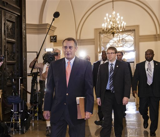 Speaker of the House John Boehner, R-Ohio, arrives at the Capitol in Washington, Saturday. (AP Photo/J. Scott Applewhite)