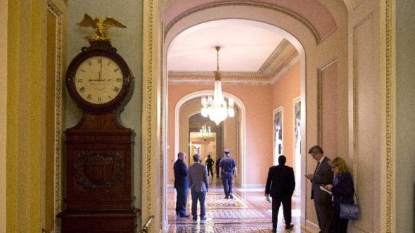 The Ohio Clock shown outside the Senate Chamber on Capitol Hill on Thursday. The Ohio Clock has stood watch over the Senate for 196 years. It stopped running shortly after noon Wednesday. Employees in the Office of the Senate Curator ordinarily wind the clock weekly.   (AP Photo/ Evan Vucci)