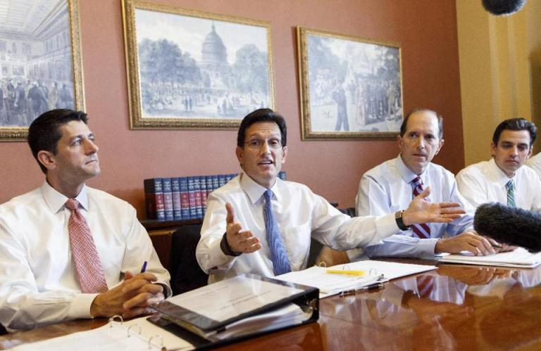 With the federal government out of money and out of time, House Majority Leader Eric Cantor, R-Va., center, meets with House GOP conferees. (AP Photo/J. Scott Applewhite)