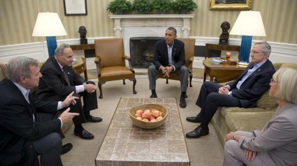 Sen. Dick Durbin, D-Ill., Sen. Charles Schumer, D-N.Y., President Barack Obama, Senate Majority Leader Harry Reid of Nev., Sen. Patty Murray, D-Wash., meet in the Oval Office of the White House.  (AP Photo/Carolyn Kaster)
