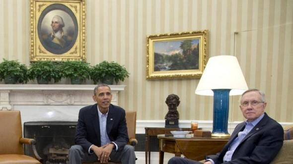 President Barack Obama, left, and Senate Majority Leader Harry Reid of Nev., look to photographers as they meet.  (AP Photo/Carolyn Kaster)