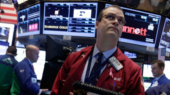 Trader William Lawrence on the floor of the New York Stock Exchange. (AP/Richard Drew)